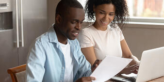 couple preparing documents for a home loan