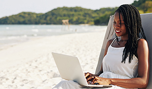 Woman conducting business on vacation