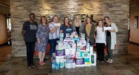 APM Employees providing household goods and a donation